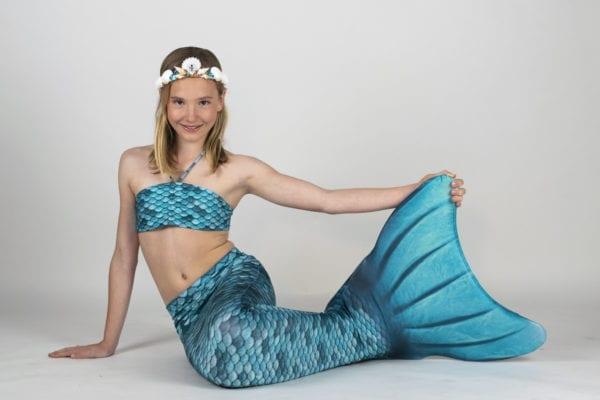 Zwemmen als een echt zeemeermin doe je in deze turquoise zeemeerminnenstaart van Kuaki Mermaids. Verkrijgbaar met of zonder bijpassende bikini.